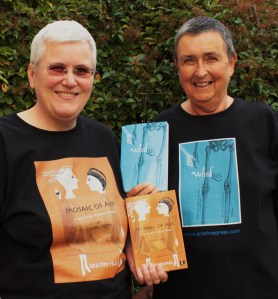 Cherry Potts, Arachne author and founder, with partner Alix Adams, in celebratory T-shirts