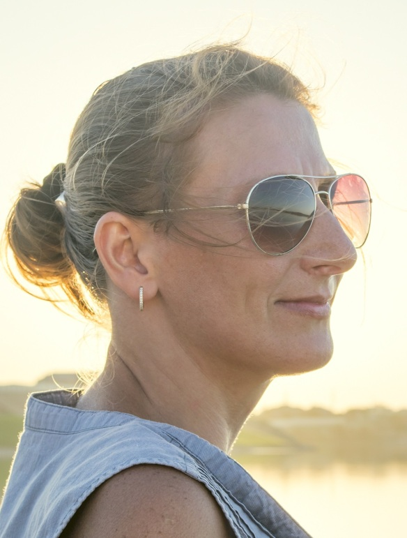 middle-aged woman in sunglasses